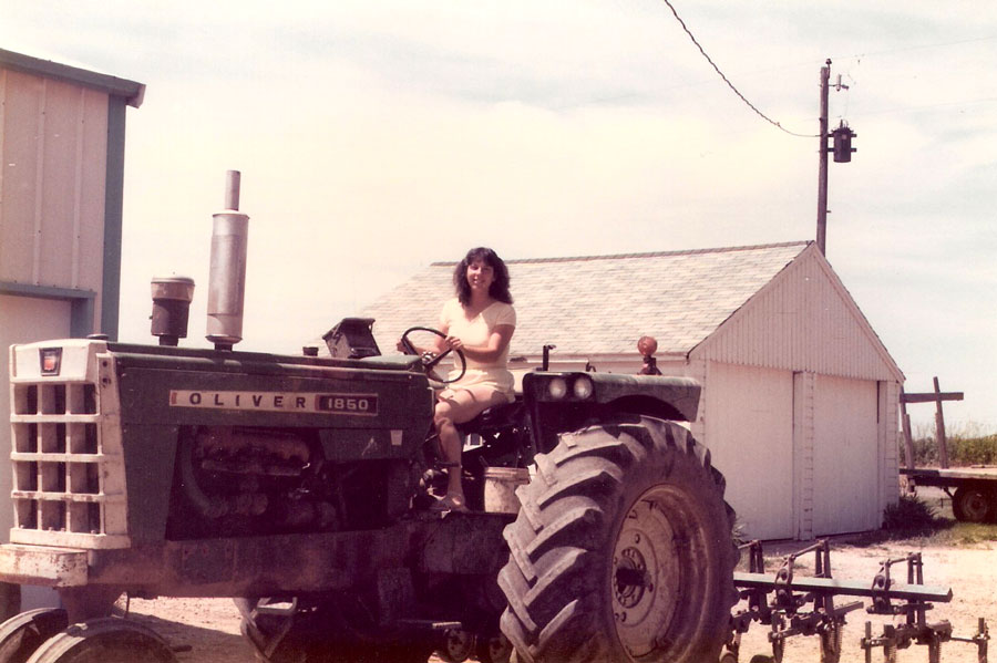 Kari on a tractor while visiting Suzzy Boggus in Illinois - mid-80's